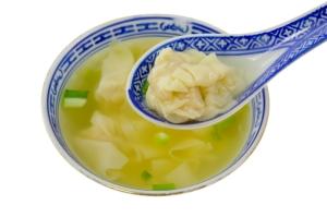 Dumpling soup with spoon